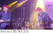 Купить «Vocalist of rock band Lyapis-98 singing with expression during concert in Sala Apolo, Barcelona», видеоролик № 30787213, снято 22 ноября 2018 г. (c) Яков Филимонов / Фотобанк Лори