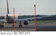 Купить «Airplane start position before departure», видеоролик № 30787317, снято 21 июля 2017 г. (c) Игорь Жоров / Фотобанк Лори