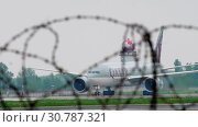 Купить «Cargo airplane taxiing after landing», видеоролик № 30787321, снято 4 мая 2019 г. (c) Игорь Жоров / Фотобанк Лори