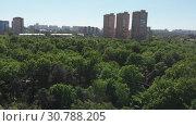 Купить «The Cityscape in Khimki city and Tolstogo park from above. Russia», видеоролик № 30788205, снято 22 мая 2019 г. (c) Володина Ольга / Фотобанк Лори