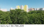 Купить «The Cityscape of Levoberezhnyy district in Khimki city. Russia», видеоролик № 30788209, снято 22 мая 2019 г. (c) Володина Ольга / Фотобанк Лори