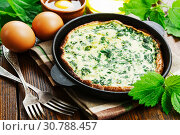 Купить «Omelet with nettles», фото № 30788457, снято 17 мая 2019 г. (c) Надежда Мишкова / Фотобанк Лори