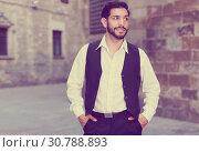 Waist up portrait of man near cathedral. Стоковое фото, фотограф Яков Филимонов / Фотобанк Лори