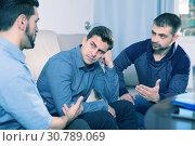 Купить «Two troubled men talking with friend», фото № 30789069, снято 10 января 2018 г. (c) Яков Филимонов / Фотобанк Лори