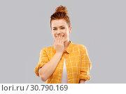 Купить «confused red teenage girl covering mouth by hand», фото № 30790169, снято 28 февраля 2019 г. (c) Syda Productions / Фотобанк Лори