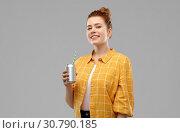 Купить «young woman or teenage girl drinking soda from can», фото № 30790185, снято 28 февраля 2019 г. (c) Syda Productions / Фотобанк Лори