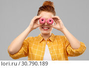 Купить «funny teenage girl with donuts instead of eyes», фото № 30790189, снято 28 февраля 2019 г. (c) Syda Productions / Фотобанк Лори