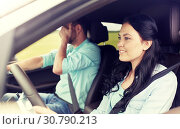Купить «woman driving car and man covering face with palm», фото № 30790213, снято 12 июня 2016 г. (c) Syda Productions / Фотобанк Лори