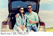 Купить «happy couple with coffee at hatchback car trunk», фото № 30790217, снято 12 июня 2016 г. (c) Syda Productions / Фотобанк Лори