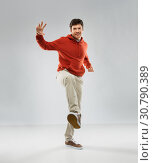 happy young man in hoodie stepping up. Стоковое фото, фотограф Syda Productions / Фотобанк Лори