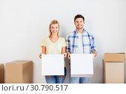 Купить «happy couple with boxes moving to new home», фото № 30790517, снято 25 февраля 2016 г. (c) Syda Productions / Фотобанк Лори
