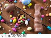 Купить «chocolate eggs, easter bunny and candies on wood», фото № 30790581, снято 22 марта 2018 г. (c) Syda Productions / Фотобанк Лори