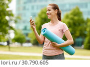 Купить «woman with exercise mat and smartphone at park», фото № 30790605, снято 15 июня 2018 г. (c) Syda Productions / Фотобанк Лори
