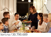 Купить «happy family having dinner party at home», фото № 30790689, снято 15 декабря 2018 г. (c) Syda Productions / Фотобанк Лори