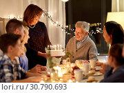 Купить «happy family having birthday party at home», фото № 30790693, снято 15 декабря 2018 г. (c) Syda Productions / Фотобанк Лори