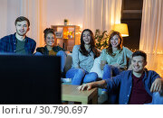 Купить «happy friends watching tv at home in evening», фото № 30790697, снято 22 декабря 2018 г. (c) Syda Productions / Фотобанк Лори
