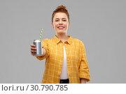 Купить «young woman or teenage girl drinking soda from can», фото № 30790785, снято 28 февраля 2019 г. (c) Syda Productions / Фотобанк Лори