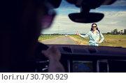 Купить «woman hitchhiking and stopping car with thumbs up», фото № 30790929, снято 12 июня 2016 г. (c) Syda Productions / Фотобанк Лори