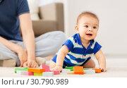 Купить «baby boy with father playing toy blocks at home», фото № 30790989, снято 5 мая 2018 г. (c) Syda Productions / Фотобанк Лори