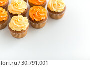Купить «cupcakes with frosting on white background», фото № 30791001, снято 6 июля 2018 г. (c) Syda Productions / Фотобанк Лори