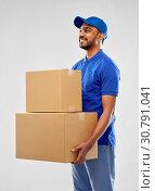 Купить «happy indian delivery man with parcel boxes», фото № 30791041, снято 12 января 2019 г. (c) Syda Productions / Фотобанк Лори