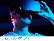 Купить «man in virtual reality headset or vr glasses», фото № 30791045, снято 3 февраля 2019 г. (c) Syda Productions / Фотобанк Лори