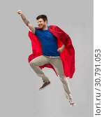 Купить «man in red superhero cape flying in air», фото № 30791053, снято 3 февраля 2019 г. (c) Syda Productions / Фотобанк Лори