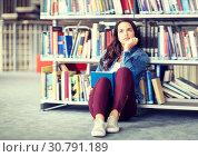 Купить «high school student girl reading book at library», фото № 30791189, снято 19 июня 2016 г. (c) Syda Productions / Фотобанк Лори