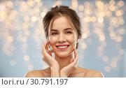 Купить «smiling young woman touching her face», фото № 30791197, снято 20 января 2019 г. (c) Syda Productions / Фотобанк Лори
