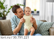 Купить «father with little baby daughter at home», фото № 30791221, снято 25 августа 2018 г. (c) Syda Productions / Фотобанк Лори