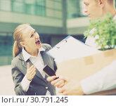 Купить «Irate woman is dismissing young manager for violating the job description», фото № 30791245, снято 15 июля 2017 г. (c) Яков Филимонов / Фотобанк Лори