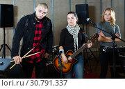 Купить «group of rock musicians posing with instruments», фото № 30791337, снято 26 октября 2018 г. (c) Яков Филимонов / Фотобанк Лори