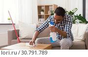 Купить «indian man cleaning table with detergent at home», видеоролик № 30791789, снято 27 апреля 2019 г. (c) Syda Productions / Фотобанк Лори