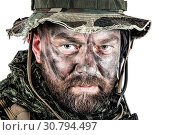 Купить «Special forces United States in Camouflage Uniforms studio shot. Wearing jungle hat, Shemagh scarf, painted face. Studio shot isolated.», фото № 30794497, снято 10 июня 2017 г. (c) age Fotostock / Фотобанк Лори