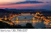 Купить «Aerial view of Budapest and illuminated landmarks at sunset», фото № 30799037, снято 29 июля 2018 г. (c) easy Fotostock / Фотобанк Лори