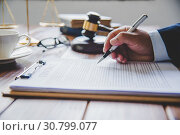 Купить «Law theme, mallet of the judge, law enforcement officers, evidence-based cases, and documents taken into account.», фото № 30799077, снято 20 августа 2018 г. (c) easy Fotostock / Фотобанк Лори