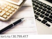 Купить «Bill and calculator with pen, paper bill charge.», фото № 30799417, снято 21 октября 2016 г. (c) easy Fotostock / Фотобанк Лори