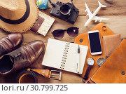 Купить «Tourism planning and equipment needed for the trip on wooden floor», фото № 30799725, снято 21 марта 2017 г. (c) easy Fotostock / Фотобанк Лори