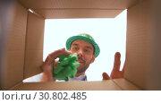 Купить «happy man opening parcel box or birthday gift», видеоролик № 30802485, снято 15 мая 2019 г. (c) Syda Productions / Фотобанк Лори