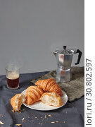 Continental breakfast with fresh croissant and natural coffee on a grey background. Стоковое фото, фотограф Ярослав Данильченко / Фотобанк Лори