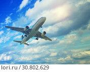 White plane in cloudy sky. Стоковое фото, фотограф Яков Филимонов / Фотобанк Лори