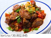 Купить «Cooked fried pork meat with peppers, mushrooms and greens», фото № 30802845, снято 19 июня 2019 г. (c) Яков Филимонов / Фотобанк Лори