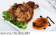 Купить «Pork steak served with greens», фото № 30802881, снято 19 июня 2019 г. (c) Яков Филимонов / Фотобанк Лори
