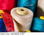 Купить «Coil Threads and measuring tape», фото № 30803197, снято 18 мая 2019 г. (c) Gennadiy Poznyakov / Фотобанк Лори