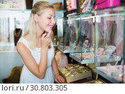 Купить «Female choosing bijouterie in glass showcase», фото № 30803305, снято 10 декабря 2019 г. (c) Яков Филимонов / Фотобанк Лори