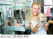 Купить «young woman in bijouterie store», фото № 30803309, снято 21 мая 2019 г. (c) Яков Филимонов / Фотобанк Лори