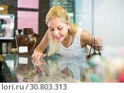 Купить «Positive customer girl looking jewellery gifts», фото № 30803313, снято 6 августа 2020 г. (c) Яков Филимонов / Фотобанк Лори