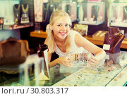 Купить «woman seller showing bracelets», фото № 30803317, снято 21 мая 2019 г. (c) Яков Филимонов / Фотобанк Лори