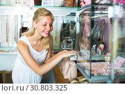 Купить «girl near glass showcase in bijouterie store», фото № 30803325, снято 21 мая 2019 г. (c) Яков Филимонов / Фотобанк Лори
