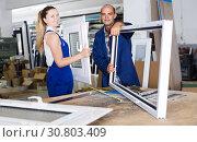 Brigade of two people working at workshop. Стоковое фото, фотограф Яков Филимонов / Фотобанк Лори